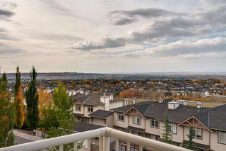 Photo 24: 6 116 Rockyledge View NW in Calgary: Rocky Ridge Row/Townhouse for sale : MLS®# A1040430