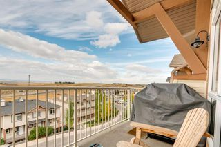 Photo 22: 6 116 Rockyledge View NW in Calgary: Rocky Ridge Row/Townhouse for sale : MLS®# A1040430