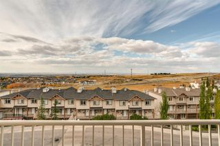 Photo 5: 6 116 Rockyledge View NW in Calgary: Rocky Ridge Row/Townhouse for sale : MLS®# A1040430