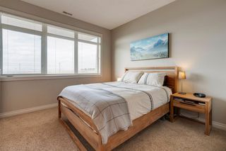 Photo 16: 6 116 Rockyledge View NW in Calgary: Rocky Ridge Row/Townhouse for sale : MLS®# A1040430
