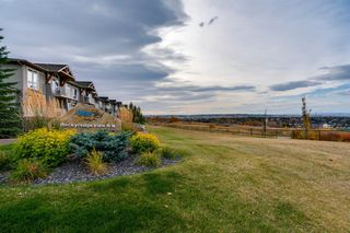 Photo 27: 6 116 Rockyledge View NW in Calgary: Rocky Ridge Row/Townhouse for sale : MLS®# A1040430