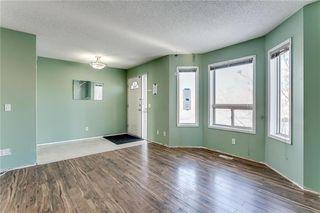 Photo 3: 128 RIVERCREST Crescent SE in Calgary: Riverbend Detached for sale : MLS®# C4278532