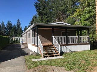 """Photo 1: 25 24330 FRASER Highway in Langley: Murrayville Manufactured Home for sale in """"Langley Grove"""" : MLS®# R2476219"""