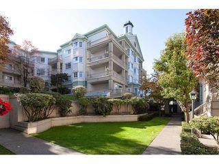 """Main Photo: 114 15268 105 Avenue in Surrey: Guildford Condo for sale in """"GEORGIAN GARDENS"""" (North Surrey)  : MLS®# R2401911"""