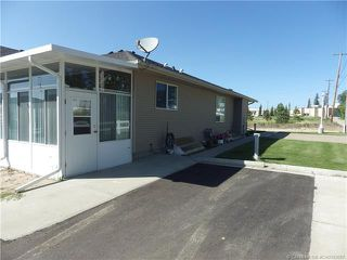 Photo 2: 10 100 Legacy Lane in Rimbey: Residential for sale : MLS®# CA0192687