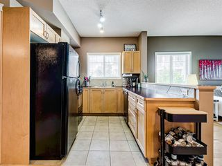 Photo 2: 9311 70 PANAMOUNT Drive NW in Calgary: Panorama Hills Apartment for sale : MLS®# A1019261