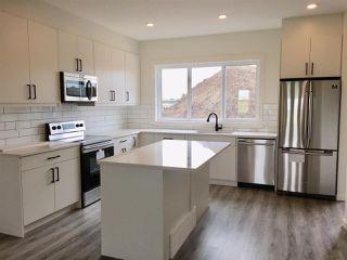 Photo 2: 309 Orchards Boulevard in Edmonton: Zone 53 House Half Duplex for sale : MLS®# E4171246