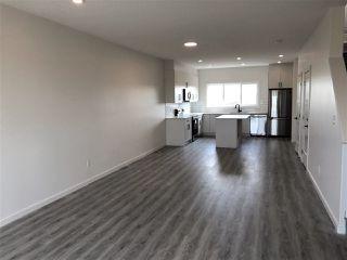 Photo 4: 309 Orchards Boulevard in Edmonton: Zone 53 House Half Duplex for sale : MLS®# E4171246