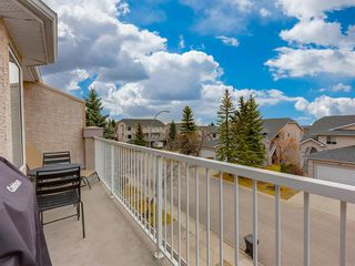 Photo 29: 316 Sierra Morena Green SW in Calgary: Signal Hill Row/Townhouse for sale : MLS®# A1047765