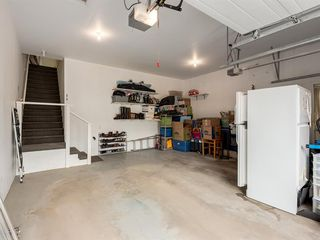 Photo 27: 316 Sierra Morena Green SW in Calgary: Signal Hill Row/Townhouse for sale : MLS®# A1047765