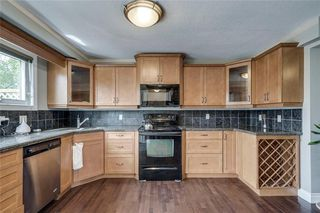 Photo 4: 2419 53 Avenue SW in Calgary: North Glenmore Park Semi Detached for sale : MLS®# C4299769