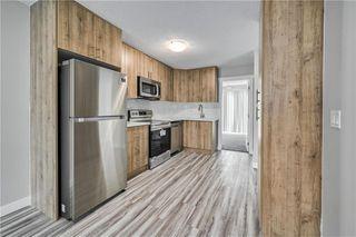 Photo 2: 13 FALCHURCH Road NE in Calgary: Falconridge Semi Detached for sale : MLS®# C4300852