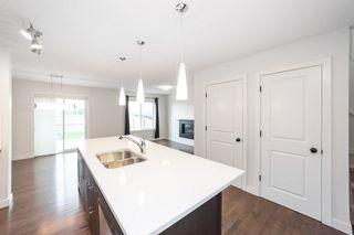 Photo 6: 1014 177A Street SW in Edmonton: Zone 56 House Half Duplex for sale : MLS®# E4204594