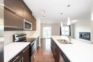 Photo 5: 1014 177A Street SW in Edmonton: Zone 56 House Half Duplex for sale : MLS®# E4204594