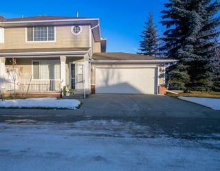 Main Photo: 31 Sierra Morena Gardens SW in Calgary: Signal Hill Row/Townhouse for sale : MLS®# A1051254