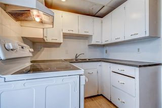 Photo 4: 834 68 Avenue SW in Calgary: Kingsland Semi Detached for sale : MLS®# A1059383