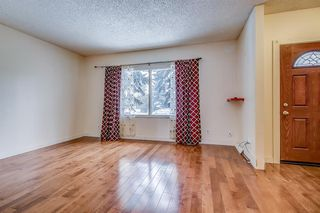 Photo 9: 834 68 Avenue SW in Calgary: Kingsland Semi Detached for sale : MLS®# A1059383