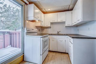 Photo 3: 834 68 Avenue SW in Calgary: Kingsland Semi Detached for sale : MLS®# A1059383
