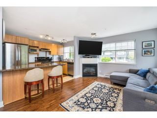 "Photo 4: 203 19388 65 Avenue in Surrey: Clayton Condo for sale in ""Liberty"" (Cloverdale)  : MLS®# R2465978"