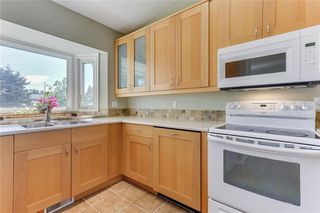Photo 10: 100 WOODBINE Boulevard SW in Calgary: Woodbine Detached for sale : MLS®# C4264383