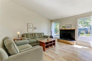 Photo 6: 100 WOODBINE Boulevard SW in Calgary: Woodbine Detached for sale : MLS®# C4264383