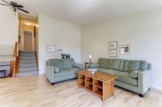 Photo 7: 100 WOODBINE Boulevard SW in Calgary: Woodbine Detached for sale : MLS®# C4264383