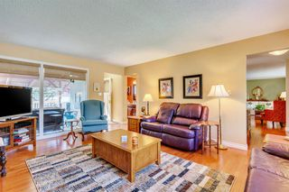 Photo 7: 831 LAKE LUCERNE Drive SE in Calgary: Lake Bonavista Detached for sale : MLS®# A1026903
