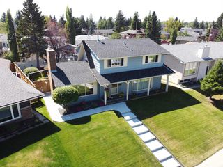 Photo 3: 831 LAKE LUCERNE Drive SE in Calgary: Lake Bonavista Detached for sale : MLS®# A1026903