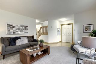 Photo 6: 310 BRIDLEWOOD Court SW in Calgary: Bridlewood Detached for sale : MLS®# A1035871