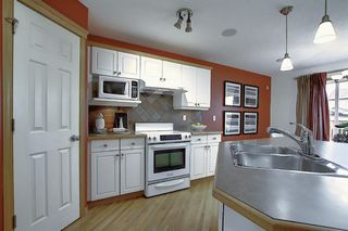 Photo 11: 310 BRIDLEWOOD Court SW in Calgary: Bridlewood Detached for sale : MLS®# A1035871