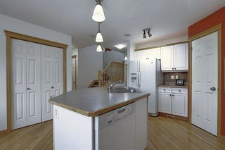 Photo 10: 310 BRIDLEWOOD Court SW in Calgary: Bridlewood Detached for sale : MLS®# A1035871