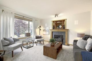 Photo 5: 310 BRIDLEWOOD Court SW in Calgary: Bridlewood Detached for sale : MLS®# A1035871