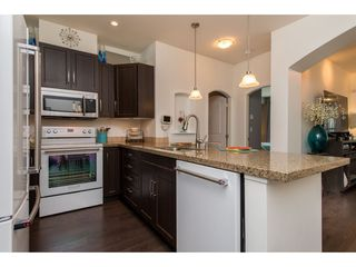 """Photo 10: 202 33485 SOUTH FRASER Way in Abbotsford: Central Abbotsford Condo for sale in """"Citadel"""" : MLS®# R2474931"""
