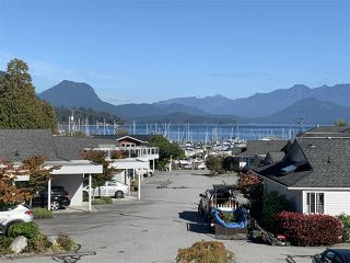 "Photo 1: 38 696 TRUEMAN Road in Gibsons: Gibsons & Area Condo for sale in ""Marina Place"" (Sunshine Coast)  : MLS®# R2507629"