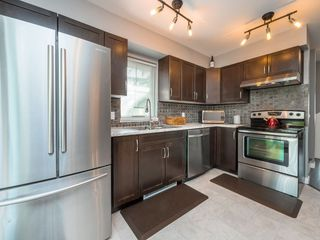 """Photo 7: 77 20760 DUNCAN Way in Langley: Langley City Townhouse for sale in """"WYNDHAM LANE"""" : MLS®# R2395742"""