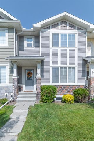 Photo 1: 5 KINGS HEIGHTS Drive SE: Airdrie Row/Townhouse for sale : MLS®# A1031520