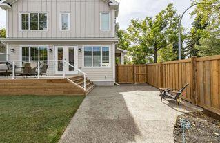 Photo 1: 7409 111 Street NW in Edmonton: Zone 15 House Half Duplex for sale : MLS®# E4215008