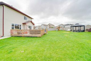 Photo 2: 3343 21 AVE in Edmonton: Zone 30 House for sale : MLS®# E4169225