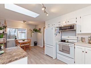 """Photo 15: 34680 2ND Avenue in Abbotsford: Poplar House for sale in """"HUNTINGDON VILLAGE"""" : MLS®# R2528448"""