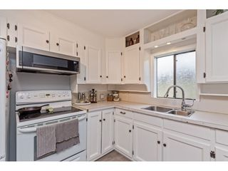 """Photo 14: 34680 2ND Avenue in Abbotsford: Poplar House for sale in """"HUNTINGDON VILLAGE"""" : MLS®# R2528448"""
