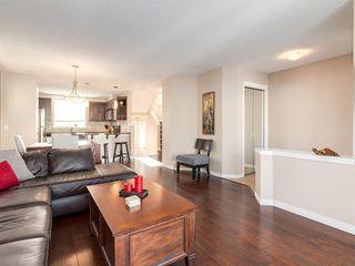 Photo 7: 69 AUTUMN Terrace SE in Calgary: Auburn Bay Detached for sale : MLS®# A1058520