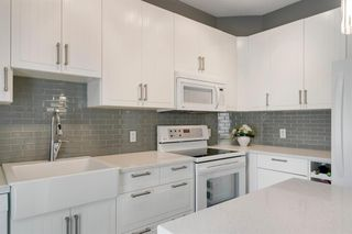 Photo 18: 26 PROMENADE Way SE in Calgary: McKenzie Towne Row/Townhouse for sale : MLS®# A1015071