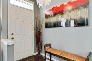 Photo 2: 26 PROMENADE Way SE in Calgary: McKenzie Towne Row/Townhouse for sale : MLS®# A1015071