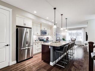 Photo 2: 252 QUARRY PARK Boulevard SE in Calgary: Douglasdale/Glen Row/Townhouse for sale : MLS®# A1045762