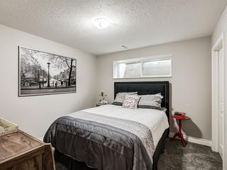 Photo 29: 252 QUARRY PARK Boulevard SE in Calgary: Douglasdale/Glen Row/Townhouse for sale : MLS®# A1045762
