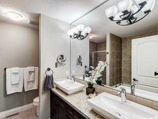 Photo 23: 252 QUARRY PARK Boulevard SE in Calgary: Douglasdale/Glen Row/Townhouse for sale : MLS®# A1045762