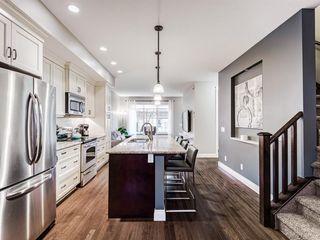 Photo 3: 252 QUARRY PARK Boulevard SE in Calgary: Douglasdale/Glen Row/Townhouse for sale : MLS®# A1045762