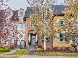 Photo 1: 252 QUARRY PARK Boulevard SE in Calgary: Douglasdale/Glen Row/Townhouse for sale : MLS®# A1045762