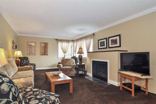 """Photo 2: 205 20460 54 Avenue in Langley: Langley City Condo for sale in """"Wheatcroft Manor"""" : MLS®# R2518368"""