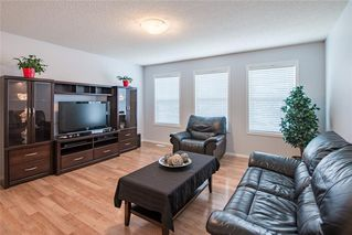 Photo 8: 299 CIMARRON Boulevard: Okotoks Detached for sale : MLS®# C4257704